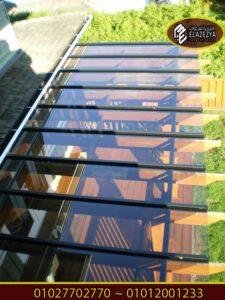 برجولات زجاج سيكوريت بتغطية خشبية